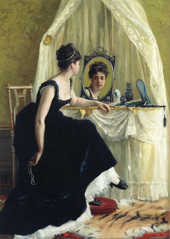 Auf dem Bild ist eine Frau zu sehen. Sie schaut sich im Spiegel an.