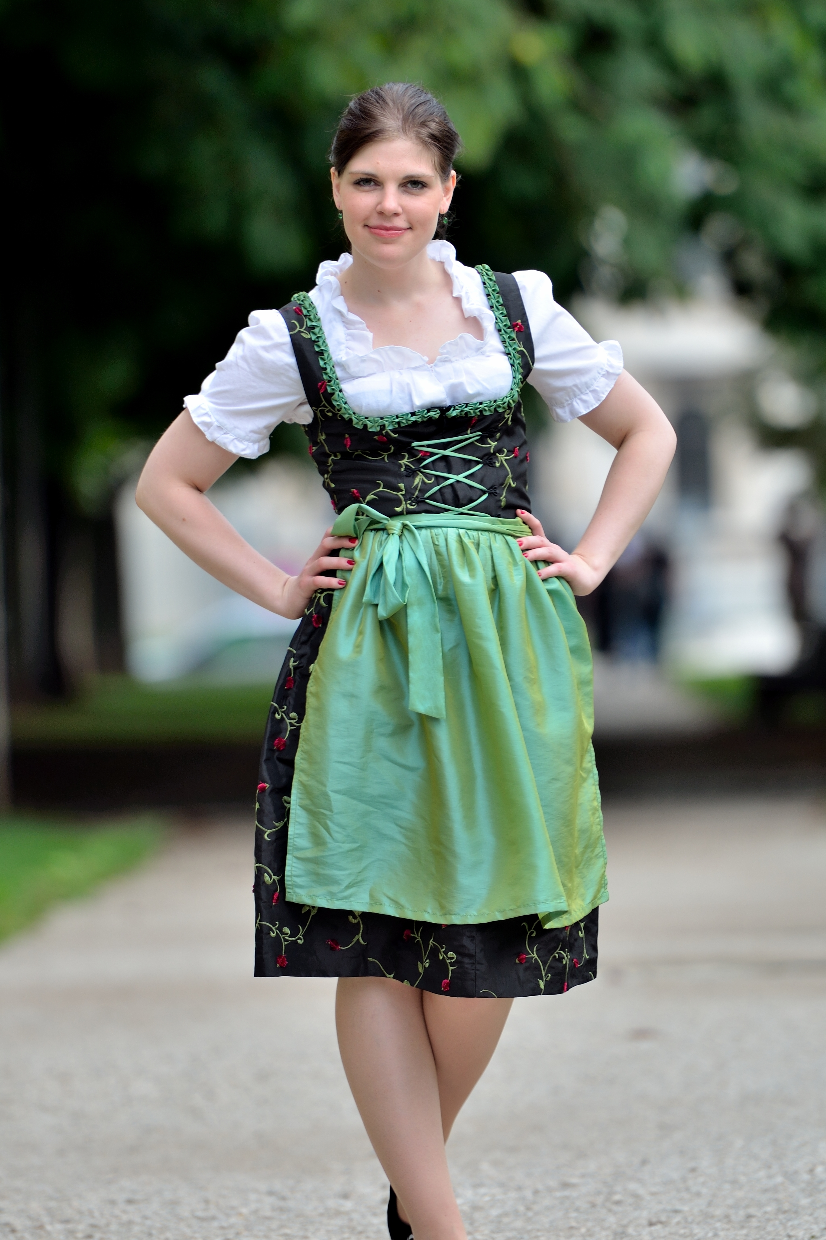 On the picture is a woman. The woman is wearing a Dirndl Dress with apron and Dirndl blouse.